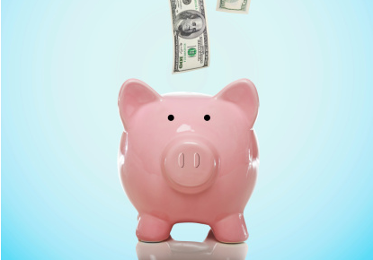 piggy bank with bills crop